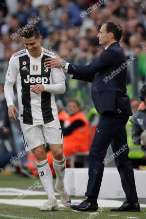 Juventus coach Massimiliano Allegri, right, talks Cristiano Ronaldo during a Serie A soccer match between Juventus and AC Fiorentina, at the Allianz stadium in Turin, Italy, . Juventus needs a draw against visiting Fiorentina to clinch a record-extending eighth straight Serie A title