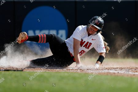 Lamar University's Jade Lewis (81) slides into home plate to score a run during an Northwestern State University at Lamar University NCAA softball game on in Beaumont, Texas