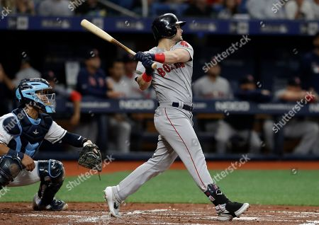 Michael Perez, Andrew Benintendi. Boston Red Sox's Andrew Benintendi follows the flight of his grand slam off Tampa Bay Rays starting pitcher Charlie Morton during the second inning of a baseball game, in St. Petersburg, Fla. Catching for the Rays is Michael Perez