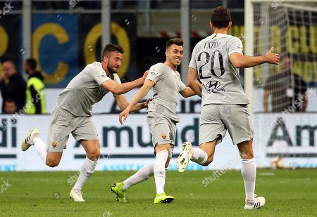 Roma's Stephan El Shaarawy  (C) jubilates with his teammates Bryan Cristante (L) and Federico Fazio  after scoring the 0-1 goal during the Italian serie A soccer match between FC Inter and AS Roma  at Giuseppe Meazza stadium in Milan, Italy, 20 April 2019.