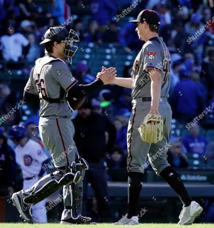 Stock Picture of Taylor Clarke, John Ryan Murphy. Arizona Diamondbacks relief pitcher Taylor Clarke, right, celebrates with catcher John Ryan Murphy after the Diamondbacks defeated the Chicago Cubs in a baseball game, in Chicago