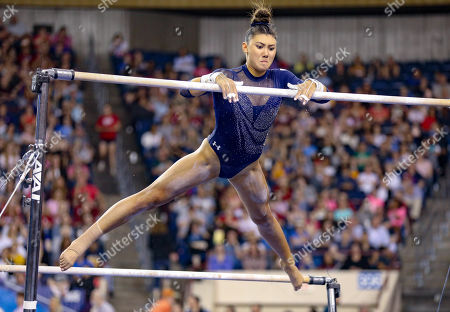 UCLA's Kyla Ross transitions between the bars during the NCAA Women's National Collegiate Gymnastics Championship Finals at the Fort Worth Convention Center in Fort Worth, TX