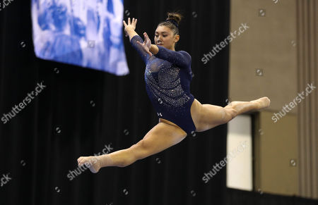 UCLA's Kyla Ross performs on the balance beam during the NCAA Women's National Collegiate Gymnastics Championship Finals at the Fort Worth Convention Center in Fort Worth, TX