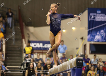 UCLA's Madison Kocian performs on beam during the NCAA Women's National Collegiate Gymnastics Championship Finals at the Fort Worth Convention Center in Fort Worth, TX