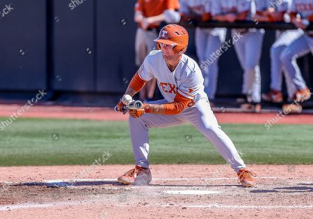 University of Texas infielder Lance Ford (28) attempts a bunt during a baseball game between the University of Texas Longhorns and Oklahoma State Cowboys at Allie P. Reynolds Stadium in Stillwater, OK