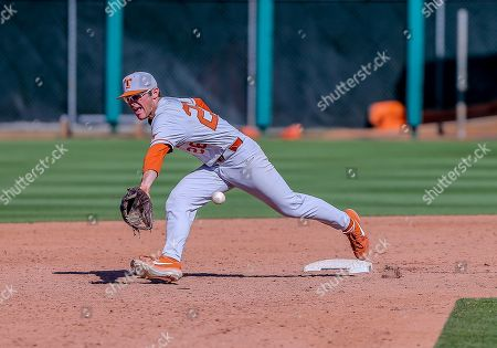 University of Texas infielder Lance Ford (28) fields a ball during a baseball game between the University of Texas Longhorns and Oklahoma State Cowboys at Allie P. Reynolds Stadium in Stillwater, OK