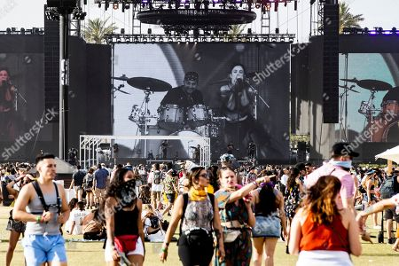Stock Photo of People walk in front of the stage where US singer Sabrina Claudio is performing during the Coachella Valley Music and Arts Festival in Indio, near Palm Spring, California, USA, 21 April 2019. The festival will run from 12 April to 21 April 2019.