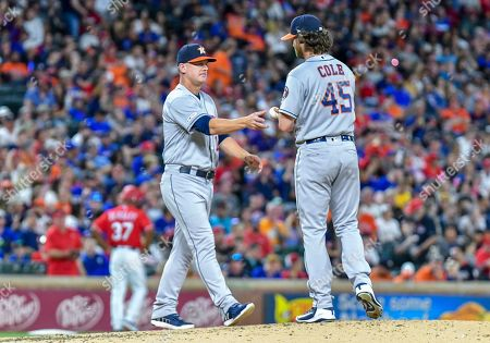 Houston Astros starting pitcher Gerrit Cole #45 hands the ball to Houston Astros manager AJ Hinch #14 in the bottom of the fifth inning during an MLB game between the Houston Astros and the Texas Rangers at Globe Life Park in Arlington, TX Texas defeated Houston 9-4 Albert Pena/CSM