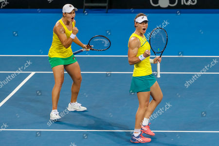 Sam Stosur (R) and Ash Barty (L) of Australia celebrate winning the first set during their doubles match against Aryna Sabalenka and Victoria Azarenka of Belarus, during the Fed Cup World Group semifinal between Australia and Belarus at Pat Rafter Arena in Brisbane, Australia, 21 April 2019.