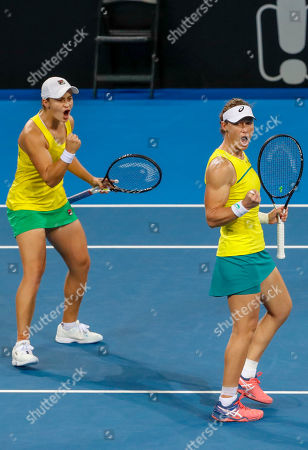 Stock Image of Sam Stosur (R) and Ash Barty (L) of Australia celebrate winning the first set during their doubles match against Aryna Sabalenka and Victoria Azarenka of Belarus, during the Fed Cup World Group semifinal between Australia and Belarus at Pat Rafter Arena in Brisbane, Australia, 21 April 2019.