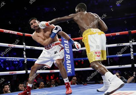Terence Crawford, right, punches England's Amir Khan during the fifth round of a WBO world welterweight championship boxing match, in New York. Crawford won the fight