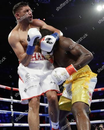 England's Amir Khan reacts to a low blow by Terence Crawford during the sixth round of a WBO world welterweight championship boxing match, in New York. Crawford won the fight when Kahn could not continue