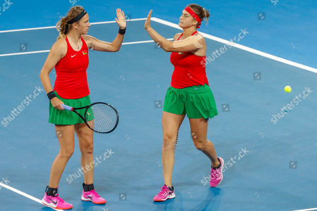 Aryna Sabalenka (right) and Victoria Azarenka (left) of Belarus celebrate winning the second set against Sam Stosur and Ash Barty of Australia during the Fed Cup World Group semifinal between Australia and Belarus at Pat Rafter Arena in Brisbane, Australia, 21 April 2019.