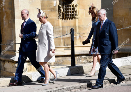 Stock Picture of (L-R) Mike Tindall and Zara Phillips with Britain's Princess Beatrice and Prince Andrew of York arrive for the annual Easter Sunday Service at St Georges Chapel in  Windsor Castle, Britain, 21 April 2019. The Easter Mattins Service is attended every year by the Royal Family. This year the service falls on the Queen's Elizabeth II birthday.