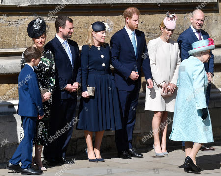 Stock Photo of (L-R) Britain's James Viscount Severn, Sophie, Countess of Wessex, Peter Phillips, Autumn Phillips, Prince Harry Duke of Sussex, Zara Phillips and Mike Tindall look as Queen Elizabeth (R) arrives for the annual Easter Sunday Service at St Georges Chapel in  Windsor Castle, Britain, 21 April 2019. The Easter Mattins Service is attended every year by the Royal Family. This year the service falls on the Queen's Elizabeth II birthday.