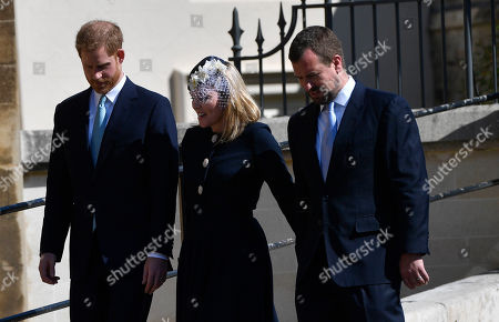 (L-R) Britain's Prince Harry, Duke of Sussex, Autumn Phillips, and Peter Phillips arrive for the annual Easter Sunday Service at St Georges Chapel in  Windsor Castle, Britain, 21 April 2019. The Easter Mattins Service is attended every year by the Royal Family. This year the service falls on the Queen's Elizabeth II birthday.