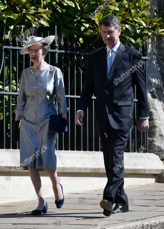Stock Photo of Britain's Princess Anne (L) and her husband Timothy Laurence (R) arrive for the annual Easter Sunday Service at St Georges Chapel in  Windsor Castle, Britain, 21 April 2019. The Easter Mattins Service is attended every year by the Royal Family. This year the service falls on the Queen's Elizabeth II birthday.