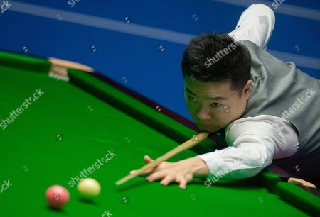 Ding Junhui of China at the table during his first round match