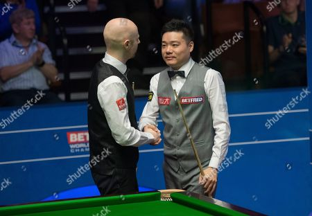 Ding Junhui of China shakes hands with Anthony McGill of Scotland after winning their first round match