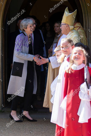 Prime Minister Theresa May chats with Lord George Carey the former Archbishop of Canterbury after the Easter Service.