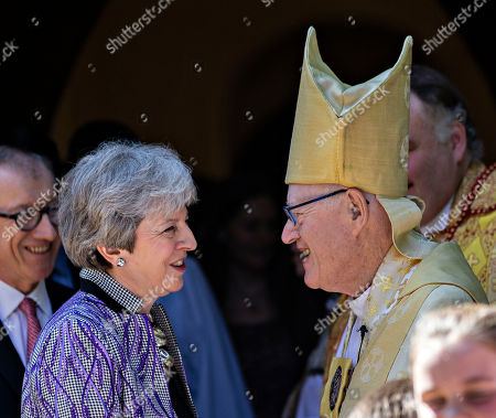 Stock Photo of Prime Minister Theresa May chats with Lord George Carey the former Archbishop of Canterbury after the Easter Service.