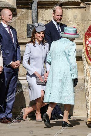 Queen Elizabeth II walks past Catherine Duchess of Cambridge and Prince William