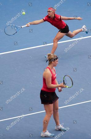 Belgian Ysaline Bonaventure (Front)  and Kirsten Flipkens in action against Spanish Garbine Muguruza and Carla Suarez Navarro  during their doubles match at the Fed Cup World Group play-off tie between Belgium and Spain, in Kortrijk, Belgium, 21 April 2019.