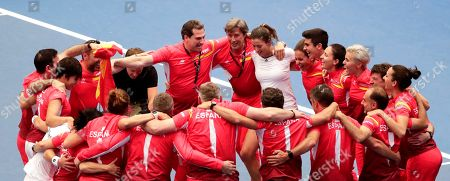 Stock Image of Spanish Garbine Muguruza and Carla Suarez Navarro celebrate with the team after winning against against Belgian Ysaline Bonaventure and Kirsten Flipkens during their doubles match at the Fed Cup World Group play-off tie between Belgium and Spain, in Kortrijk, Belgium, 21 April 2019.