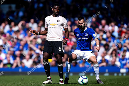 Paul Pogba of Manchester United takes on Morgan Schneiderlin of Everton