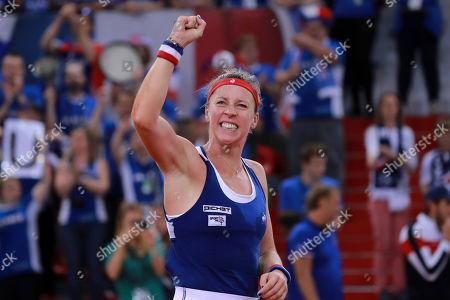 Pauline Parmentier of France celebrates after winning her game against Irina-Camelia Begu of Romania during the Fed Cup World Group, Semi Final between France and Romania, in Rouen, France, 21 April 2019.