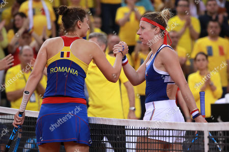Pauline Parmentier (R) of France shakes hand after winning her game against Irina-Camelia Begu (L)  of Romania during the Fed Cup World Group, Semi Final between France and Romania, in Rouen, France, 21 April 2019.