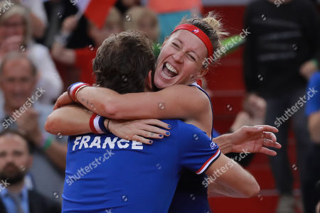 Pauline Parmentier of France celebrates with the coach Julien Benneteau (L) after winning her game against Irina-Camelia Begu of Romania during the Fed Cup World Group, Semi Final between France and Romania, in Rouen, France, 21 April 2019.