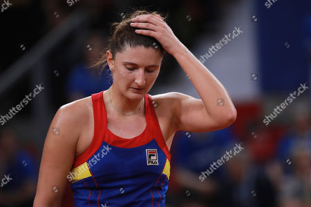 Irina-Camelia Begu of Romania reacts   during her game against Pauline Parmentier of France during the Fed Cup World Group, Semi Final between France and Romania, in Rouen, France, 21 April 2019.