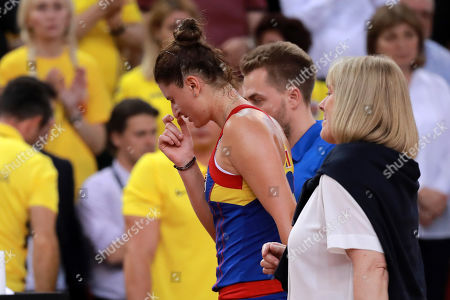 Irina-Camelia Begu of Romania reacts after being injured during her game against Pauline Parmentier of France during the Fed Cup World Group, Semi Final between France and Romania, in Rouen, France, 21 April 2019.