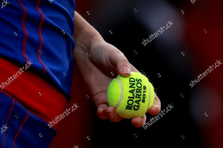 Irina-Camelia Begu of Romania holds a tennis ball reading  'Roland Garros 2019' during her game against Pauline Parmentier of France during the Fed Cup World Group, Semi Final between France and Romania, in Rouen, France, 21 April 2019 (issued 22 April 2019.