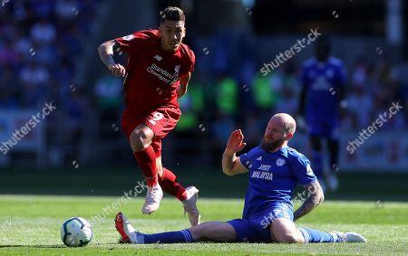Roberto Firmino of Liverpool goes past Aron Gunnarsson of Cardiff City