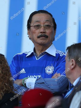 Stock Photo of Cardiff City owner Vincent Tan wears a club shirt over a collared shirt