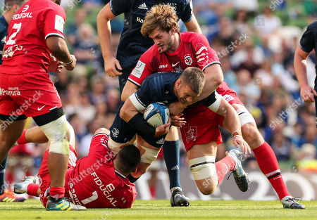 Stock Photo of Leinster vs Toulouse. Toulouse's Clement Castets and Richie Gray tackle Sean O'Brien of Leinster