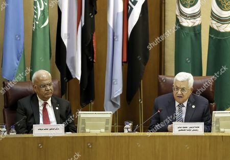 Palestine President Mahmoud Abbas (R) and Chief Palestinian negotiator Saeb Erekat attend an Arab League foreign ministers emergency meeting to discuss the Palestinian situation, at the Arab League headquarters in Cairo, Egypt, 21 April 2019. Abbas is attending an extraordinary meeting of Arab foreign ministers to discuss the latest developments in the Palestinian situation.
