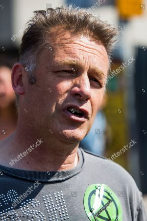 Chris Packham joins protesters on Waterloo Bridge