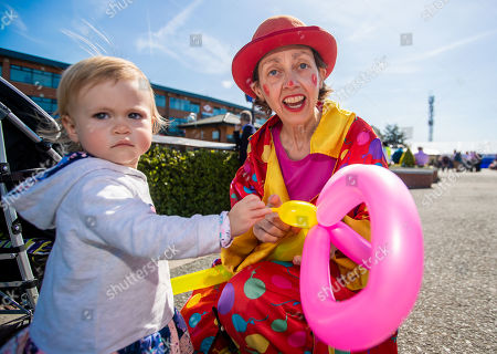 18 month old Saibh Curtis with Silly Sally the clown