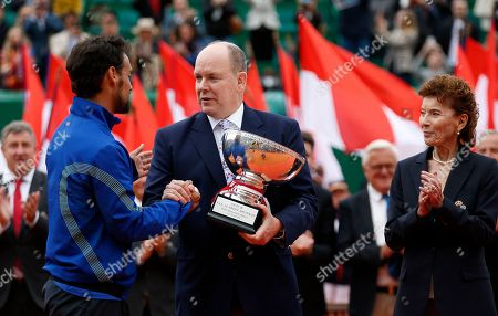 Fabio Fognini of Italy (L) poses with his trophy next to Prince Albert II of Monaco (C) and Monegasque Tennis Federation Elisabeth-Anne de Massy (R) after his final match against and Dusan Lajovic of Serbia at the Monte-Carlo Rolex Masters tournament in Roquebrune Cap Martin, France, 21 April 2019.