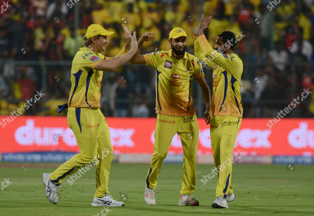 Chennai Super Kings Ravindra Jadeja, right, Shane Watson, left and Imran Tahir celebrate the wicket of Royal Challengers Bangalore's AB Devilliers, during the VIVO IPL T20 cricket match between Royal Challengers Bangalore and Chennai Super Kings in Bangalore, India