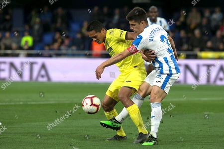 Villarreal's forward Carlos Bacca (L) duels for the ball against Leganes' Unai Bustinza during the Spanish LaLiga match between Villarreal CF and CD Leganes at La Ceramica stadium in Vila-real, eastern Spain, 21 April 2019.