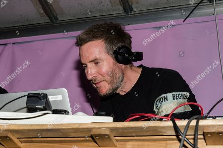 Robert del Naja, aka 3D, of Massive Attack plays a dj set to crowds gathered at Extinction Rebellion rally at Marble Arch on day seven of protest action.