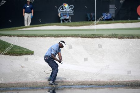 American track and field sprinter Noah Lyles trains at the National Training Center in Clermont, Florida. Vijay Singh, of Fiji Islands, hits from a bunker onto the 17th green during the second round of the Arnold Palmer Invitational golf tournament, in Orlando, Fla