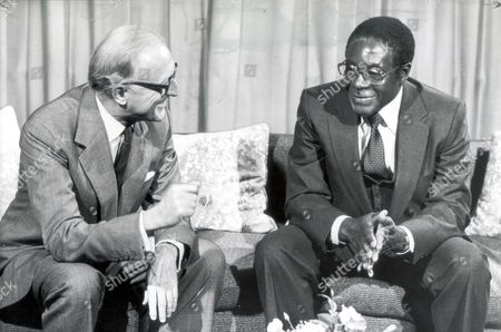 Robert Mugabe President 1980 Foreign Secretary Lord Carrington And The President Of Zimbabwe Robert Mugabe At The Savoy Hotel Today Before Having A Working Lunch Together There. Robert Mugabe Yesterday Twice Repeated His Threat To Expel Lieutenant General Peter Walls The Former Head Of The Armed Forces. General Walls Created A Storm Recently When He Said He Asked Mrs Thatcher To Annual Zimbabwe's Pre-independence Elections Because Of Alleged Intimidation By Mr. Mugabe's Guerillas....presidents