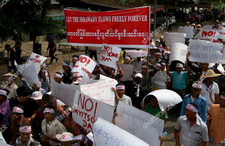 Kachin people and children hold placards during a protest held in opposition to the Irrawaddy Myitsone Dam project in Waingmaw, Kachin State, Myanmar, 22 April 2019. The dam, which is being built by the Myanmar government and the China Power Investment Corporation (CPI), will be the fifteenth largest hydroelectric power plant in the world if it is completed. In 2011, former Myanmar president Thein Sein announced the suspention of the project due to protests. The project was orginally scheduled to be completed in 2017.