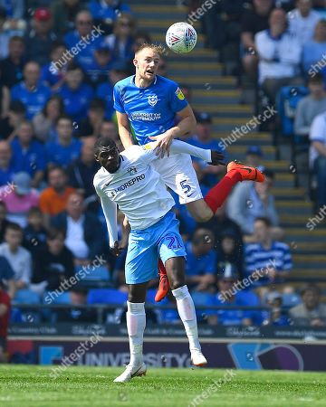 Stock Image of Matthew Clarke of Portsmouth wins a header from Amadou Bakayoko of Coventry City during Portsmouth vs Coventry City, Sky Bet EFL League 1 Football at Fratton Park on 22nd April 2019