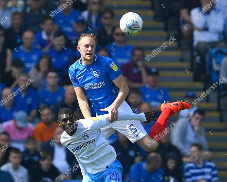 Matthew Clarke of Portsmouth wins a header from Amadou Bakayoko of Coventry City during Portsmouth vs Coventry City, Sky Bet EFL League 1 Football at Fratton Park on 22nd April 2019